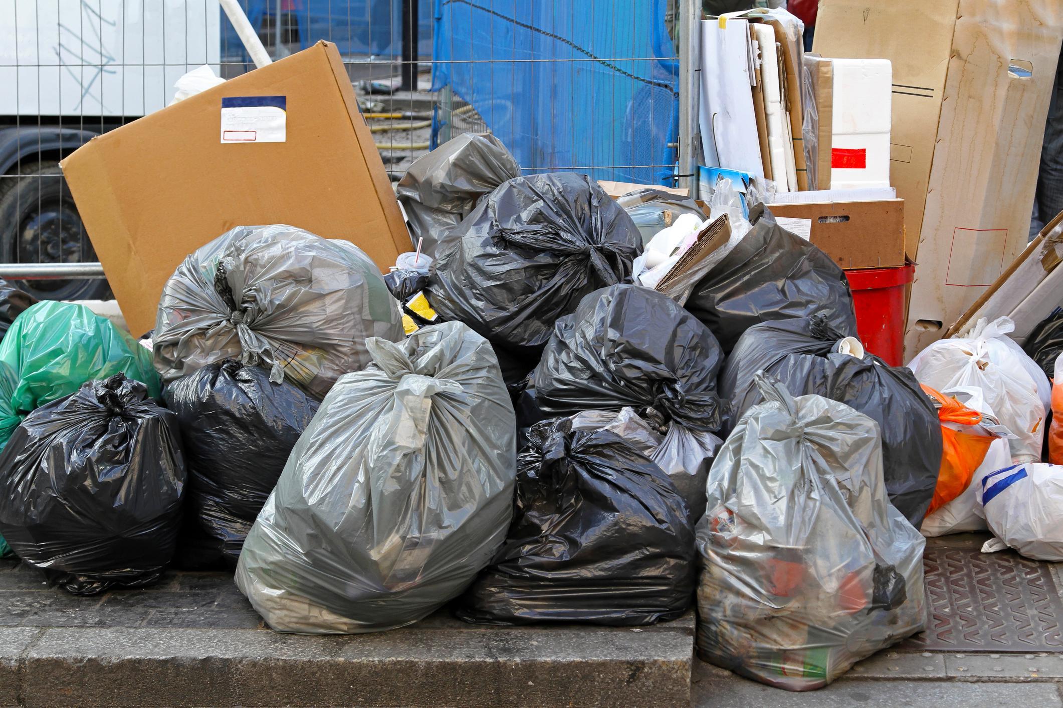 tons of black garbage bags