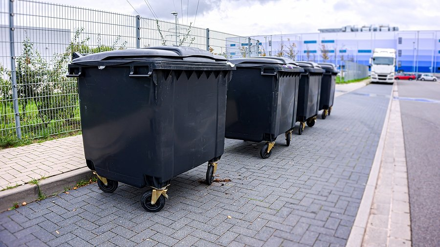 small black city garbage containers