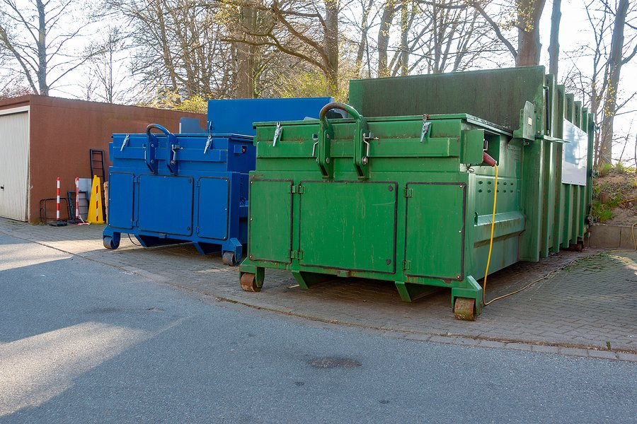 two large garbage compactors